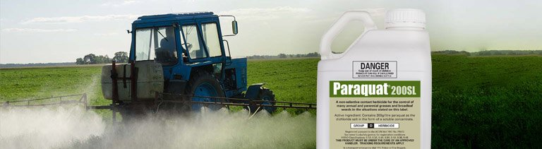 A tractor spraying paraquat